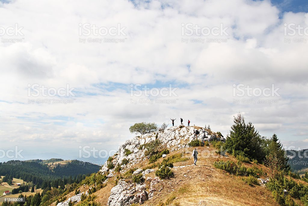 Hikers on a mountain top stock photo