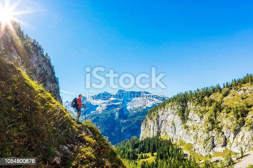 istock Hikers on a mountain trail at Berchtesgaden National Park near Koenigssee- Landtal 1054800876