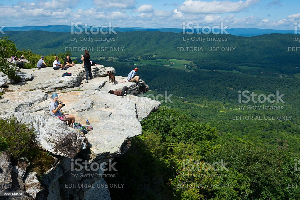 Hikers on Appalachian Trail at McAfee Knob on Catawba Mountain stock photo
