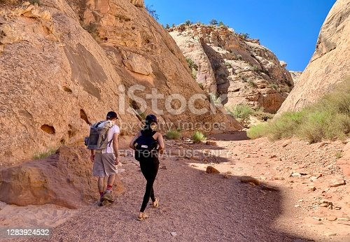 Capitol Reef National Park, Utah, USA - September 5, 2020: Hikers are walking on Capitol Gorge trail in Capitol Reef National Park in Utah.