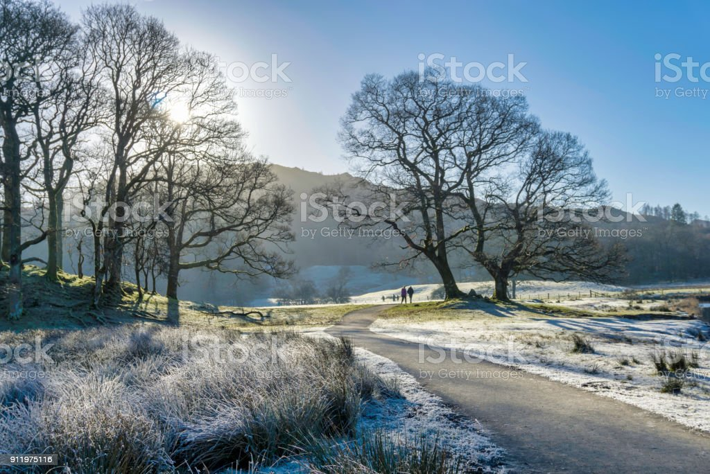 Hikers on frosty morning in Langdale stock photo