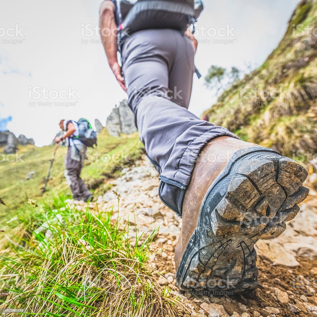 Hikers on mountain trail royalty-free stock photo