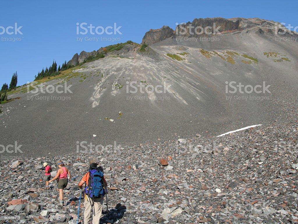 Hikers on Rock Field Below Ring Mountain stock photo