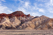 Furnace Creek, California, USA - March 7, 2020: Hikers embark from the Golden Canyon trailhead in Death Valley National Park, Furnace Creek, California, USA.