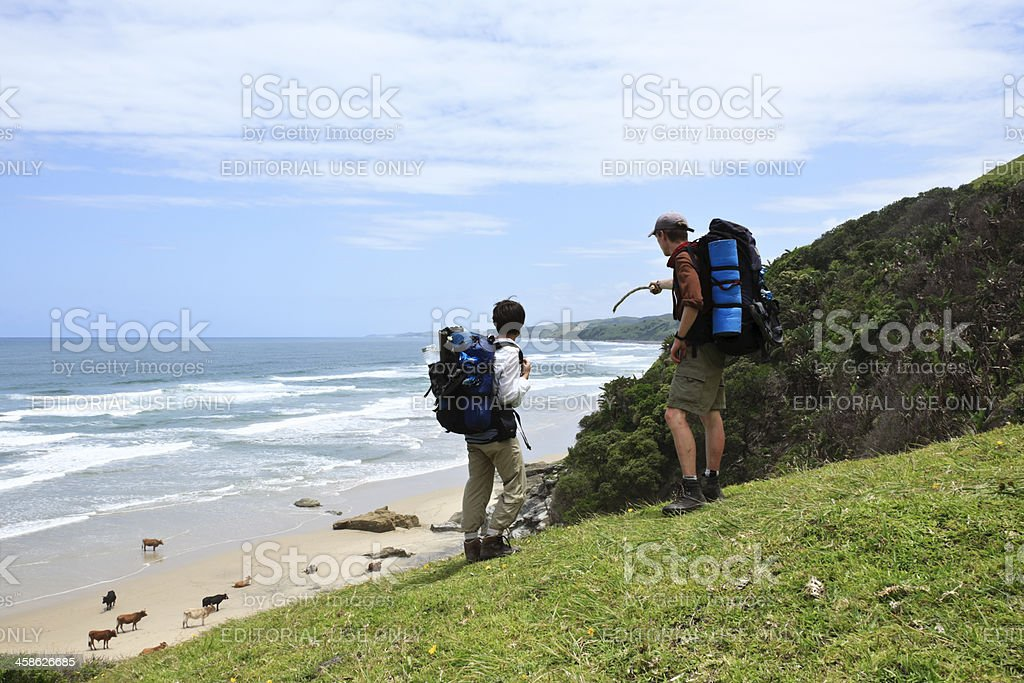 Hikers on the Transkei coast in South Africa. stock photo