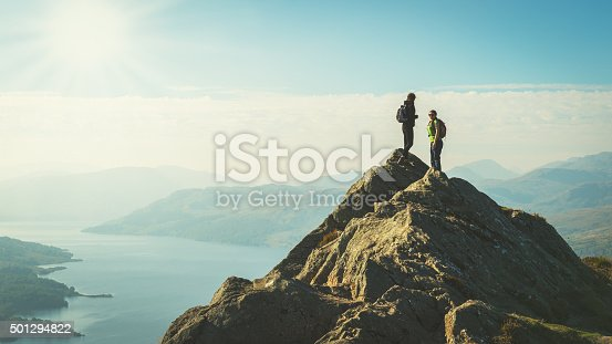 istock Hikers on top of mountain enjoying view, Loch Katrine, Scotland 501294822