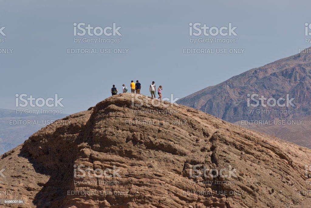Hikers on Zabriskie Point stock photo