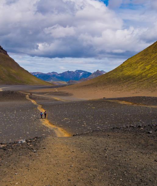 Hikers Pass through basalt flats stock photo