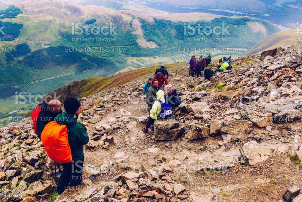 Hikers resting on Ben Nevis path, Scotland stock photo