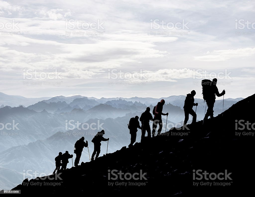 Hikers Silhouetted At Dusk stock photo