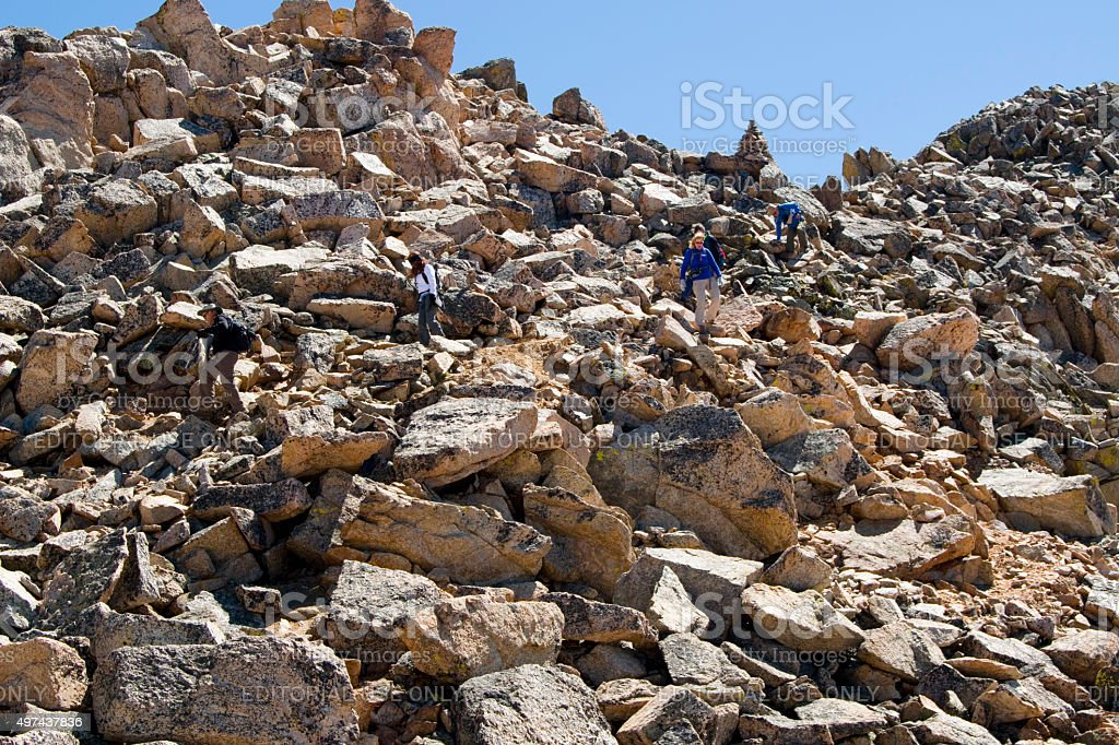 Hikers Tackle Boulder Field on Mount Yale Colorado stock photo