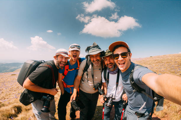 Hikers taking a selfie picture id957699284?b=1&k=6&m=957699284&s=612x612&w=0&h=wipom9zwrn8hyjczdkoauy5rj qjequmwa1a7lyr4 q=