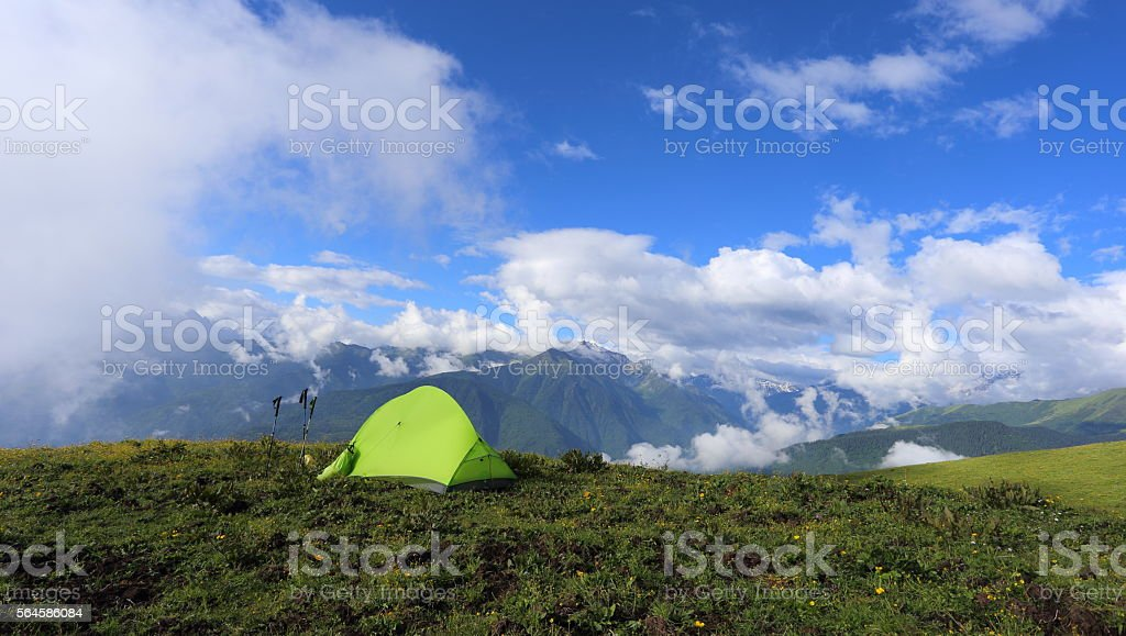 Hiker's tent on the high mountain stock photo