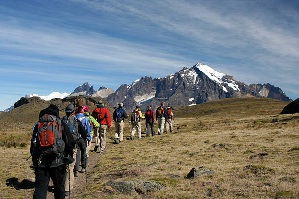 Hikers trekking in mountains in Patagonia stock photo
