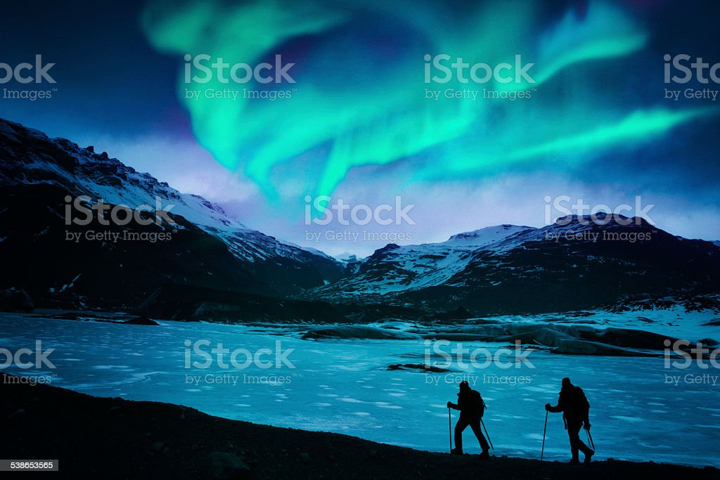 Hikers Under the Northern Lights Hikers under the northern lights in Iceland. 2015 Stock Photo