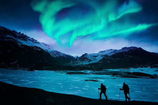 Hikers Under The Northern Lights Stock Photo - Download Image Now