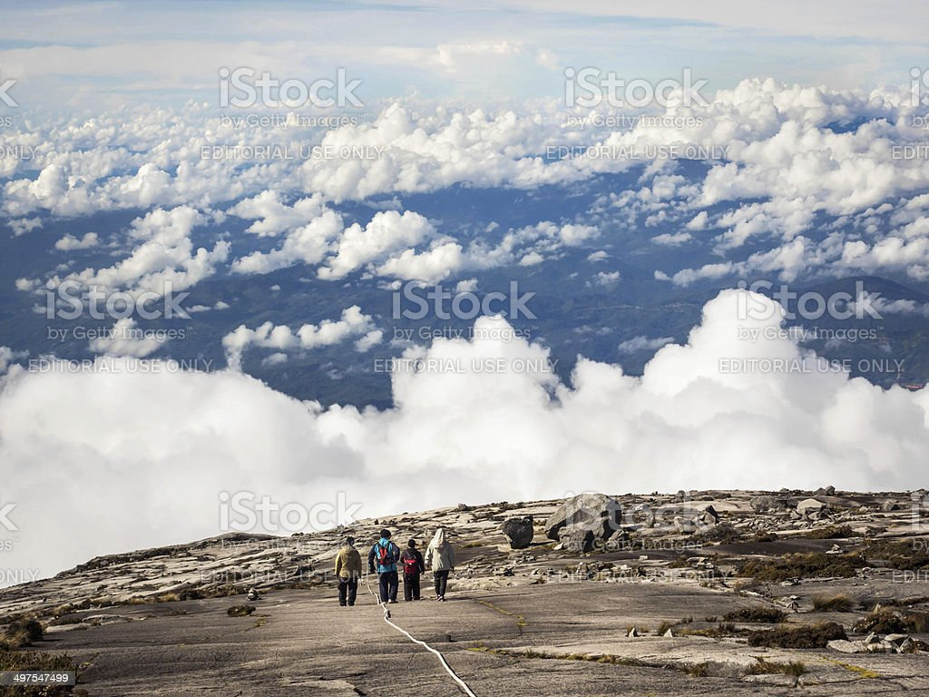 Hikers Walking at the Top of Mount Kinabalu, Sabah, Malaysia stock photo
