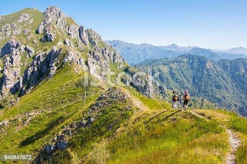 istock Hikers walking on high mountain range 845847672