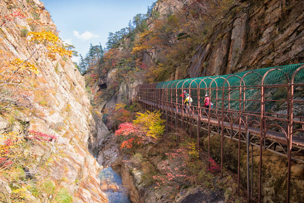Hikers Walking on the Bridge of Autumn Seoraksan Mountain stock photo