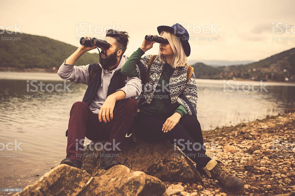 Hikers watching the view on the lake. stock photo