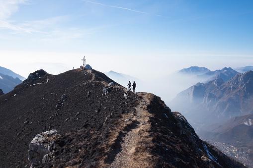 Hikers woman walking on a mountain ridge