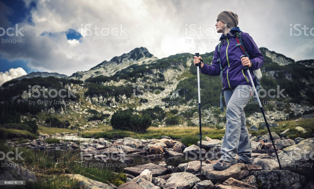 Hiking alone in the mountains stock photo