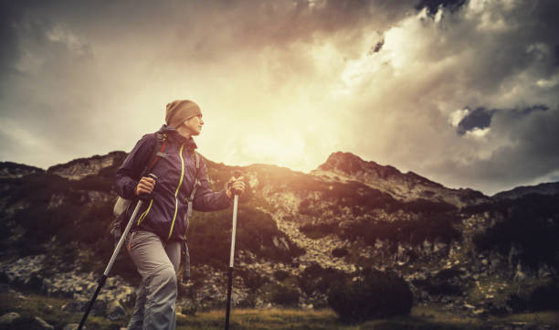 hiking alone in the mountains - adventure stock photos and pictures