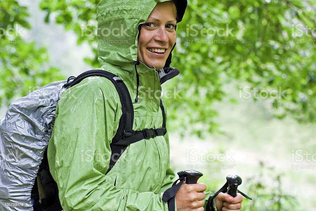 Hiking and rain in forest stock photo