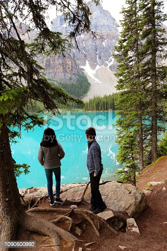 Two children hike on the trail around Moraine Lake in Banff National Park in the the Canadian Rocky Mountains