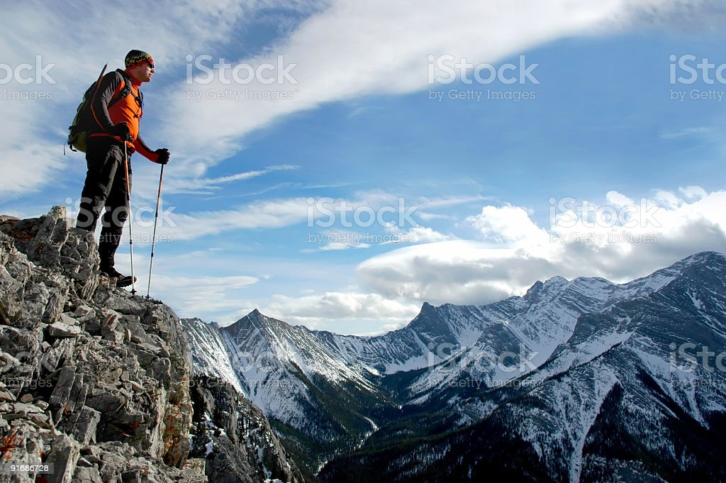 Hiking at the edge of a mountain royalty-free stock photo