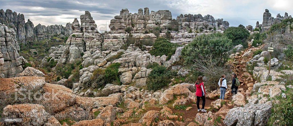 Hiking between strange landforms in El Torcal de Antequera stock photo
