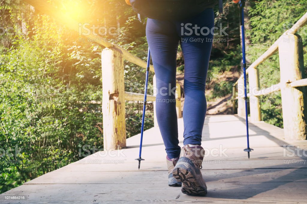 Hiking Boots Closeup Girl Tourist Steps On A Wooden Trailn