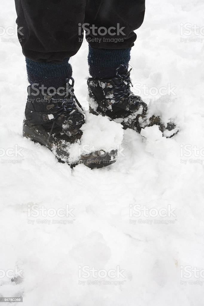 Hiking boots in snow royalty-free stock photo