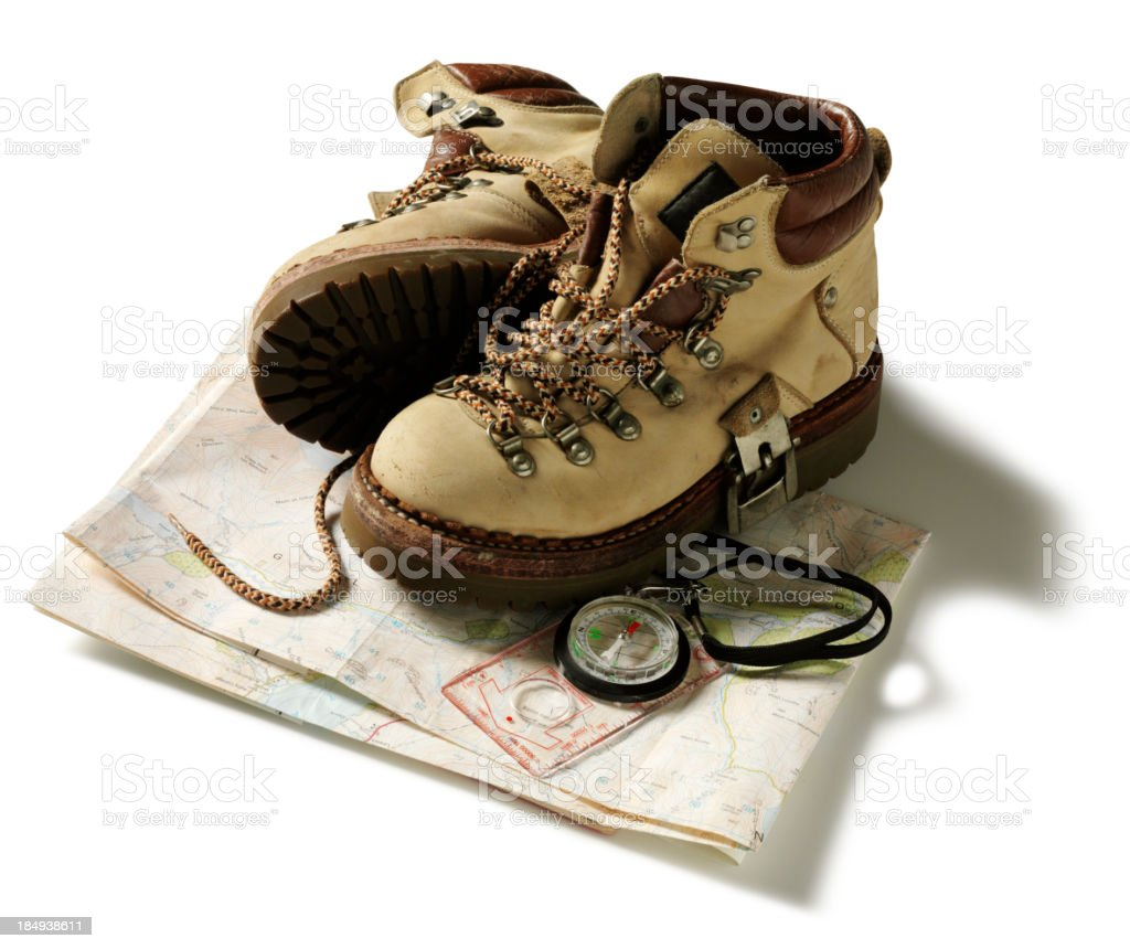 Hiking Boots on a Walking Map royalty-free stock photo