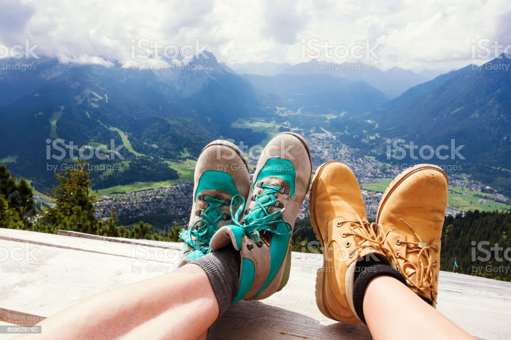 Hiking Boots Relaxing in Front of a Panoramic View stock photo