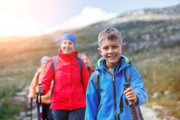 Hiking boy in the mountains stock photo