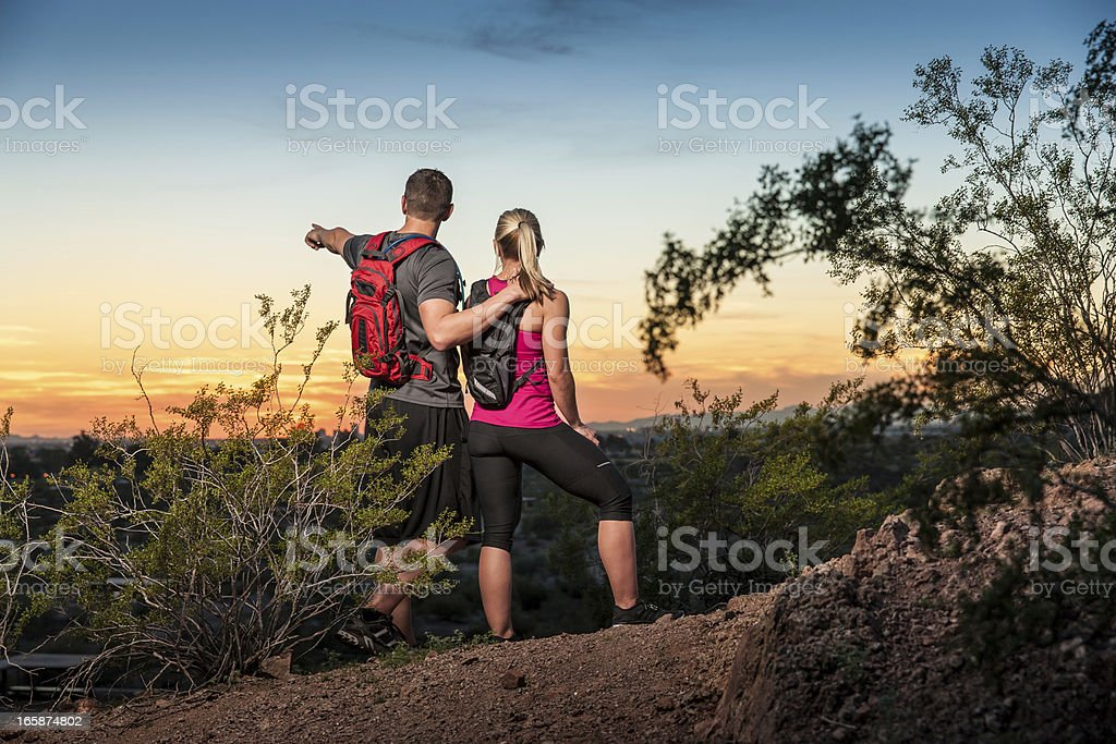 Hiking Couple Admiring the Sunset stock photo
