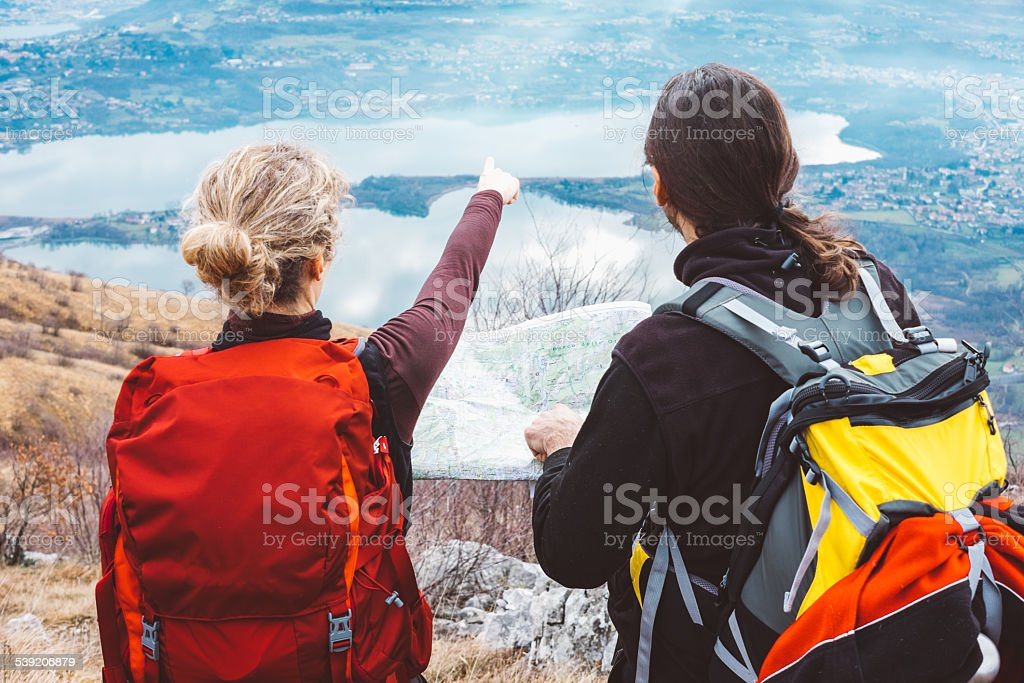Hiking couple with map in mountain royalty-free stock photo
