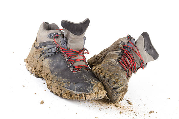 hiking dirty boots - dirty shoes stock photos and pictures