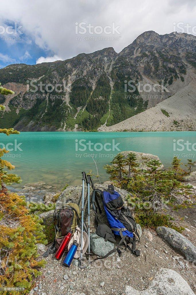 Hiking Equipment at Edge of Alpine Lake stock photo