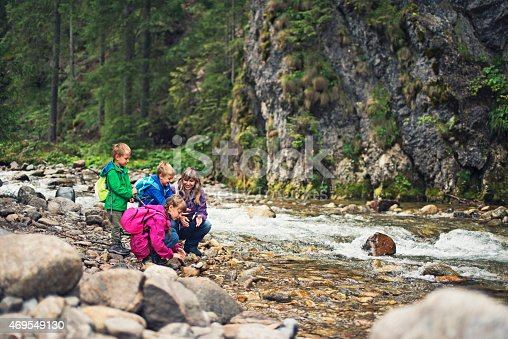 istock Hiking family at the bank of the beautiful moutain river. 469549130