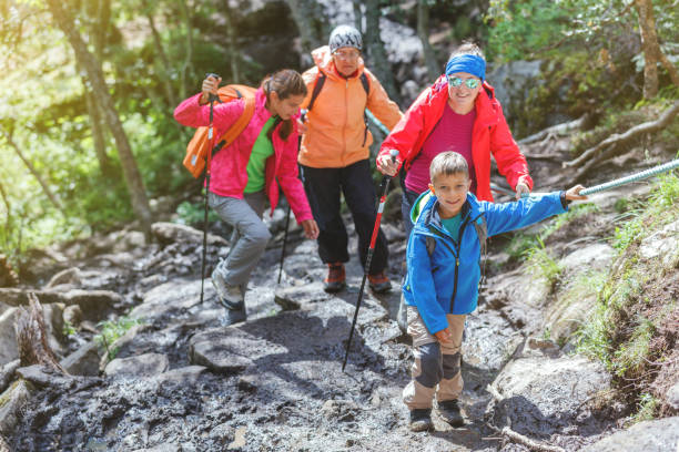 Hiking family in the mountains stock photo