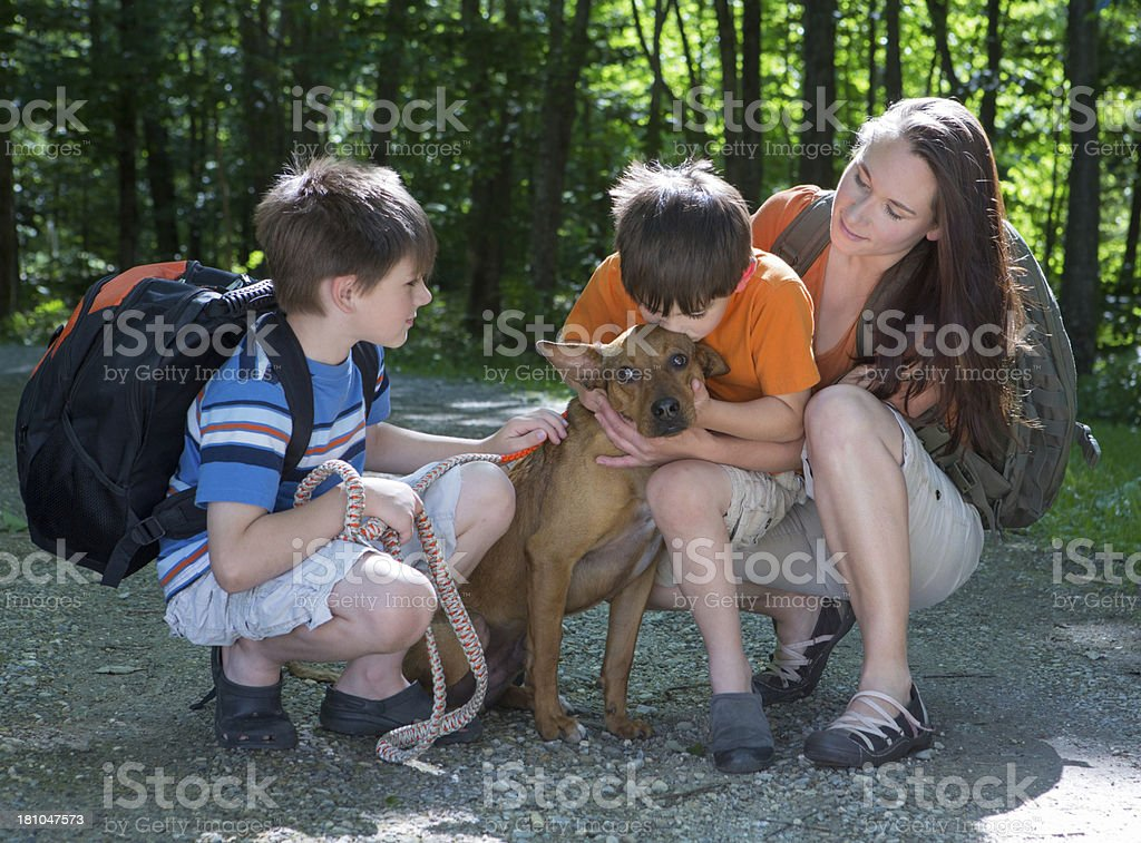 Hiking Family Reunited with Dog royalty-free stock photo