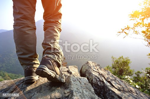 hiking feet  mountain peak rock enjoy the view