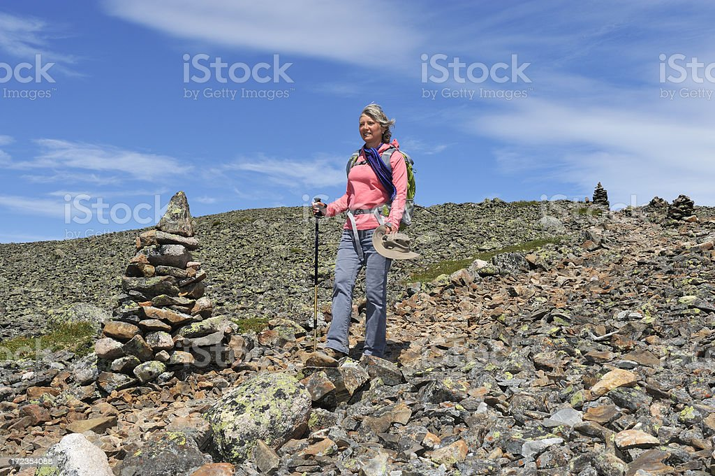 Hiking following inukshuks royalty-free stock photo