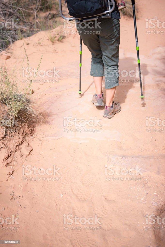 Hiking footprints in desert sand stock photo