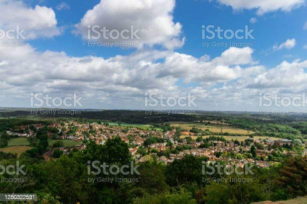 Photo of Hiking Hill Altitude View of Town Under Blue Cloudy Sky