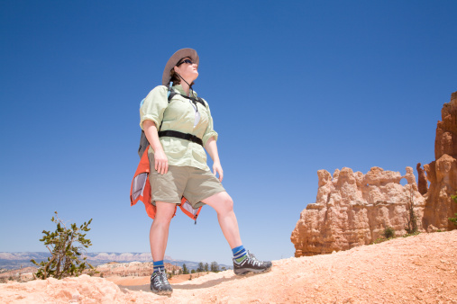A woman is hiking through Bruce Canyon in Utah