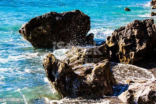 View of the Cretan wild sea coastline from the beach