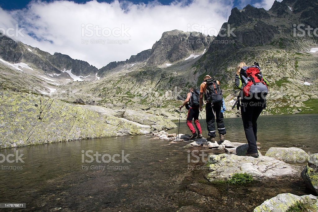 Hiking in high mountains stock photo